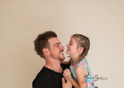 dad-daughter-laughing-studio-portrait